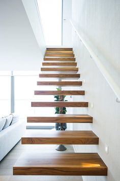 a floating staircase with no railing and banister creates a modern floating look than with them House Staircase, Staircase Design, Stair Design, Staircases, Interior Stairs, Interior Design Living Room, Cantilever Stairs, Timber Stair, Escalier Design