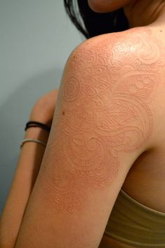 goldenwintersun:  Love this! I wonder if anyone in town does scarification. I'd be so down.   White ink tattoo. I have two of them. This isn...