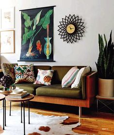 This interior features mostly earthy tones, but the print and cushions with plant designs lift those up with their bright blues and yellows. The botanical print with its typical wooden poles was used in education; look for similar ones in antique stores and markets.