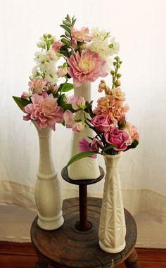 I love milk glass! pretty flowers, nice centerpiece idea!