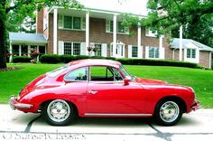 Red 1965 Porsche 356c.  This is a coupe but I prefer the white walls.  Love a red interior as well.  Plan on adding some hp to motor.  No, that is not my house in the background.