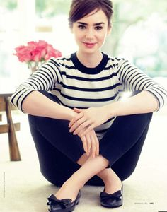 Lily Collins styles her London Sole Knightsbridge flat with a pair of black cropped trousers and a classic striped tee.