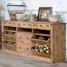 A beautiful storage solution with old farmhouse charm, this general store style sideboard made of old pine, features many drawers of different sizes, multiple shelves, and pull out bins for all your kitchen or dining room storage needs. Pallet Kitchen Cabinets, Kitchen Cabinet Design, Kitchen Furniture, Furniture Showroom, Furniture Stores, Primitive Kitchen Cabinets, Rustic Cabinets, Furniture Ideas, Furniture Nyc