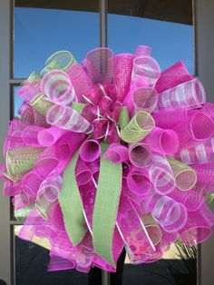 "28"" christmas spiral poly mesh wreath pink and lime green with a burlap bow. $65.00, via Etsy."