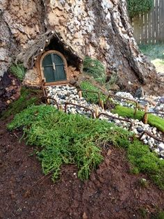 fairy houses made out of stumps   magical fairy door