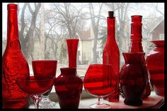 Looks similar to my small collection! I love red glass and pick up pieces in quirky places to remind me of the journey. Always makes me think of who owned the piece before I did. Bottle Vase, Bottles And Jars, Glass Bottles, Colors Of Fire, I See Red, Cranberry Glass, Simply Red, Antique Glass, Shades Of Red