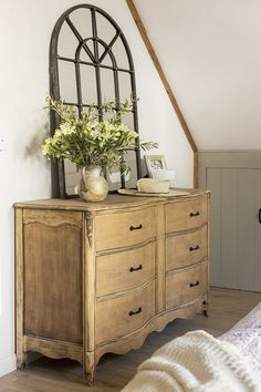 Rustic dresser with an arched mirror