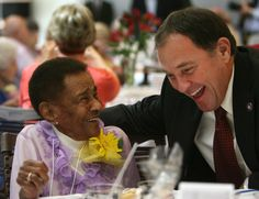 Velma Saunders, 102, laughs with Gov. Gary R. Herbert after telling him she was voting for him. She was part of the 26th Annual Centenarians Day Celebration in South Jordan,  Friday, Sept. 28, 2012. (Steve Griffin | The Salt Lake Tribune)