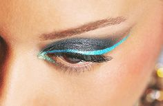 the contrast between the charcoal eyeshadow and blue eyeliner is stunning!