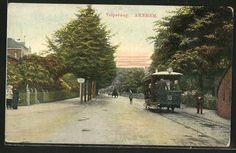 De Velperweg. Rechts kun je nog net een stukje van de Velperpoort zien.         Ergens eind 1800 gezien de paardentram?