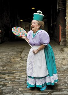 Munchkin Lollipop Lady.  In real life, she is Margaret Pelligrini who was one of the original Munchkin children. sleeping in the eggs!