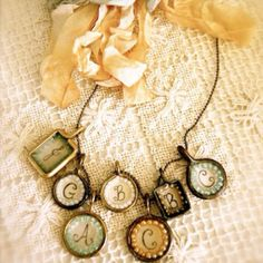 DIY jewelry-could also use glass pebbles from dollar store, homemade mod podge and origami paper with pretty designs