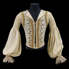 Costume by Nicholas Giorgiadis, doublet for Rudolf Nureyev in the role of Prince Florimond, Act III, in Sleeping Beauty, Teatro alla Scala, Milan, 1966. Sleeveless gray and silver waistcoat trimmed with gold lace, yellow braid, and gold filigree buttons; white false shirt with pleated sleeves and lace cuffs.