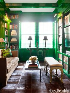 With deep green on the library's walls, Benjamin Moore's Amazon Moss, Miles Redd went for neutrals on the custom sofa, in Ralph Lauren Home's Bronson, and on the antique bench from Hinson.