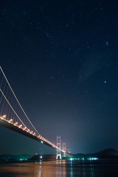 Stars lighting up the bridge, Kurushima-Kaikyo Bridge, Imabari, Ehime, Japan Beautiful Places To Visit, Places To See, Ehime, Suspension Bridge, Belleza Natural, Stargazing, Golden Gate Bridge, Night Skies, Scenery