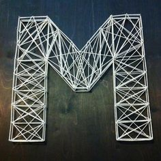 """String art - 2' x 2' (3/4"""" thick) birch wood stained, finishing nails, and natural twine. Fun and easy project!"""