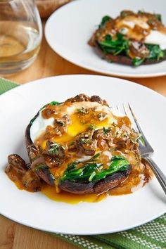 Roasted Portobello Mushrooms with Poached Eggs, Spinach, and Creamy Mushroom Sauce. Yum yum YUM!