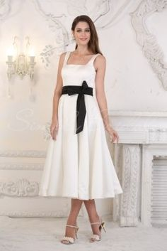 Wedding Dress by SimplyBridal. Julie. This satin gown has crisp clean lines and a universally flattering A-line silhouette. The straps offer support and the right angles of the square neckline draw the eye to the face. A sash creates the illusion of a slim waist. Since the tea-length was popu. USD $215.99