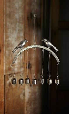Consider a different top (perhaps driftwood or recycled metal) but keep the bell configuration