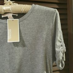 Michael Kors tee MICHAEL by Michael Kors. Grey tee with cuffed sleeves and ruched sides. Has a great slimming silhouette.  Sleeves have zippered details. 95/5% cotton /elastane MICHAEL Michael Kors Tops Tees - Short Sleeve