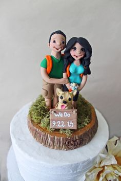This cake topper captured the couple's interest and their dog-child, too!