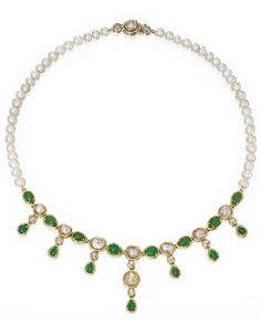18 Karat Gold, Pearl, Jadeite and Diamond Necklace  Set with 46 natural pearls measuring approximately 7.1 by 6.5 to 5.7 mm, the front accented by a fringe composed of numerous pear-shaped jadeite cabochons and pearls of various hues, accented by round and rose-cut diamonds weighing approximately 1.50 carats, length 18 inches.