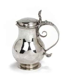 A Dutch silver mustard-pot  Mark of Pieter Kleiwert, Groningen, 1693/94  On circular foot, with plain pear-shaped body and S-scroll handle with thumb-piece, the hinged lid engraved G.L., marked on base  10.6 cm. high  102 gr.