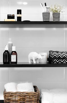 Bathroom shelf styling. Black, white, glass, ceramics, basketware