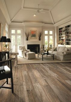 Wood Tile Floor In Living Room. White Palette, With A Little Drama From The  Black Shades On The Lamps. (By The Way, That Gorgeous Wood Floor Is  Actually ...
