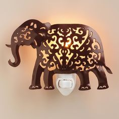 Handcrafted in India with an intricate cutout design, our whimsical elephant-shaped night-light creates ambient illumination for a hallway or bedroom, and makes a beautiful gift.