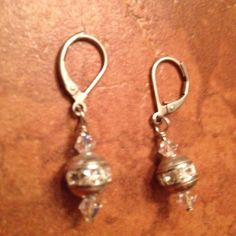 A personal favorite from my Etsy shop https://www.etsy.com/listing/227106585/vintage-silver-and-rhinestone-dangle