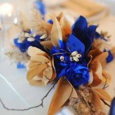 DIY Paper Centerpiece  http://go.tipjunkie.com/dc/2538/www.thesweetestoccasion.com/2011/10/modern-cobalt-wedding-ideas/