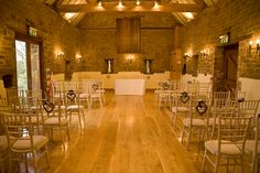 Crockwell Farm barn wedding venue. Chiavari chairs with wicker hearts and lilac and navy flowers Our Wedding 21st Dec 2013