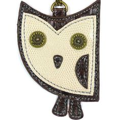 """Chala Key fob / Coin Purse - HooHoo Owl at The Handbag Store •Conveniently small, fun and functional. •Hold your keys and coins together with style! •Playful owl with stitches and metal button eyes •Zippered coin pocket on the back •Textured faux leather trim •Features antique brass toned hardware •Patterned fabric lining  •Material: Synthetic leather •Approx. measurements: 3.5""""W x 0.5""""D x 4.75""""H Shop in store at 253 Main St, Hill City SD or online at www.shopthehandbagstore.com"""