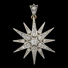 A majestic diamond starburst pin & pendant from the Victorian era! Diamonds line the entire surface of the piece, which catches the light at every turn.