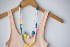 love the sophisticated feel of this homemade necklace via lightbluegrey Delighted Momma: DIY Polymer Clay Bead Necklace