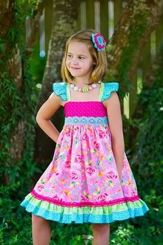 Girls handmade boutique dress in a gorgeous assortment of colorful and bright fabrics. Lovely details include flutter sleeves, elasticized back, double ruffled hem.Kinder Kouture is an online retailer for quality handmade girl's clothing with a touch Cute Little Girl Dresses, Dresses Kids Girl, Cute Dresses, Kids Outfits, Teenage Outfits, Preteen Fashion, Baby Girl Fashion, Kids Fashion, Fashion Fashion