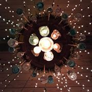 Perhaps the most beguiling chandelier ever... made from colored mason jars and mini light strings. (scheduled via http://www.tailwindapp.com?utm_source=pinterest&utm_medium=twpin)