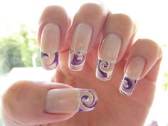 Perfect water marble nail art French tips in matte pearl white color and violet polish lined with silver beads.