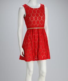 Fun, folksy fashion, this above-the-knee dress is sweet as can be with complementary colors and a floral lace overlay. A patent skinny belt and seam detailing define an hourglass silhouette.Includes dress and beltMeasurements (size M): 33'' long from high point of shoulder to hem70% cotton / 30% nylon