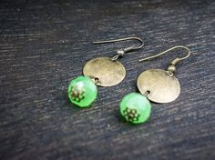 Check out this item in my Etsy shop https://www.etsy.com/listing/227385707/crystal-brass-disc-earrings-jade-red
