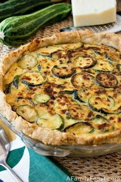 Our Zucchini Pie has a rustic olive oil crust, filled with slices of fresh garden zucchini, three kinds of cheese, and fresh garden herbs. Low Carb Zucchini Recipes, Zucchini Pie, Zucchini Tomato, Vegetable Recipes, Mixed Berry Cobbler, Italian Sausage Soup, Pie Crust Recipes, Kraut, Pie Dish