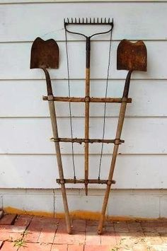 Create a trellis out of old gardening tools!