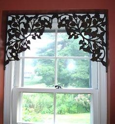 Decorative shelf brackets as window treatments....awesome.