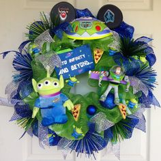 Buzz Lightyear Toy Story Wreath. I just love, love this wreath! High foil royal blue and lime green deco mesh are the base for the wreath.