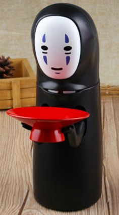 How about a piggy bank, which eats coins? The No-Face coin bank