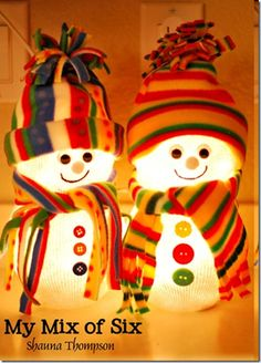 Cute Fishbowl Snowmen!.... Each Made with 2 Fish Bowls ,a String of 50 White Christmas Lights & A Man's sock. Decorate with Fleece, Buttons Etc.