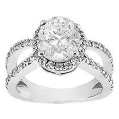 Reverse shank oval diamond ring... Might be better without the halo, but heart this one too.