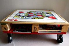 Love this idea/look - pallet coffee table on casters, w/a playing card motif.