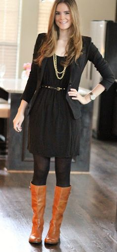 even though it's a black dress, black blazer, and black tights, the jewelry and boots balance it out